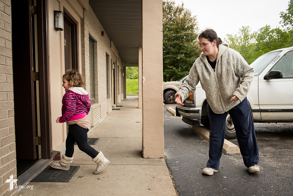 Amanda Prichard helps her daughter Madalynn into a motel on Monday, May 1, 2017, in Eureka, Mo. Local LCMS congregations and LCMS Disaster Response are assisting the Lutheran family who have been displaced due to rising flood waters. LCMS Communications/Erik M. Lunsford