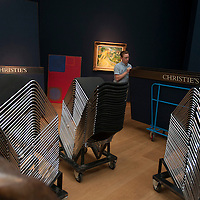 Christie's exhibition space is transformed into an auction room for the evening sale.