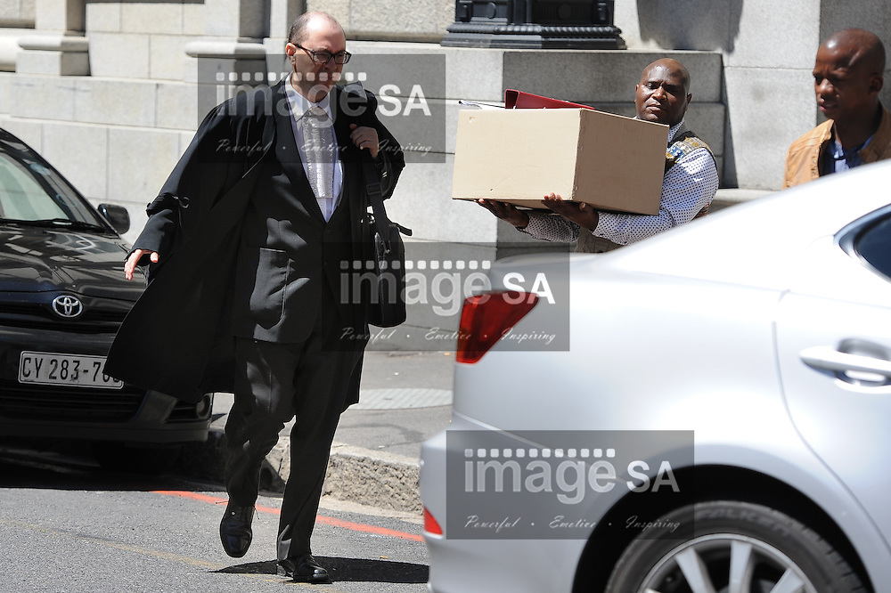 CAPE TOWN, SOUTH AFRICA - Tuesday 14 October 2014, Adrian Mopp, Senior State Prosecutor, leaves the court during Day 5 of the Shrien Dewani trial at the Western Cape High Court before Judge Jeanette Traverso. Dewani is caused of hiring hit men to murder his wife, Anni. Anni Ninna Dewani (n&eacute;e Hindocha; 12 March 1982 &ndash; 13 November 2010) was a Swedish woman who, while on her honeymoon in South Africa, was kidnapped and then murdered in Gugulethu township near Cape Town on 13 November 2010 (wikipedia).<br /> Photo by Roger Sedres