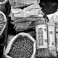 Dried dofu, noodles, peanuts and other incredients for sale in a Chengdu street market