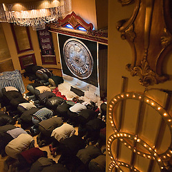 People are seen praying with Amr Khaled, Alexandria, Egypt, Dec. 24, 2005. Khaled, an Islamic televangelist, had previously been asked to leave Egypt as his revival gained strength. As a result he started preaching on several television shows, turning him into an international celebrity.