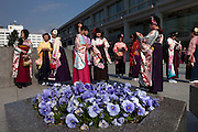 Japanese girls dressed in kimono for their university' graduation ceremony that was held in one of the rooms of the Peace Memorial Museum in Hiroshima.