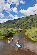 Stand up paddle boarding the Roaring Fork River east of Aspen, Colorado