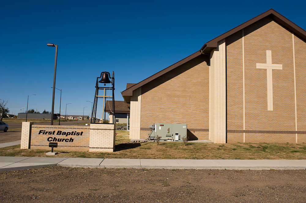 "Greensburg, Kansas, USA..First Baptist Church of Greensburg...""Greensburg: Better, Stronger, Greener!"".On May 4, 2007, an EF5 tornado cut a 1.7-mile path of destruction through Greensburg, Kansas. Winds reaching speeds of 205 miles per hour uprooted trees, demolished homes and leveled the town. Eleven people died and 95% of the buildings were destroyed beyond repair. Residents have since worked furiously to rebuild it in a way that is both economically and environmentally sustainable and to meet the highest environmental standards. Greensburg, whose population has dropped from about 1400 to 800 following the storm and is now growing again, is currently the greenest town in America and the first in the United States to pass a resolution to certify that all city-owned buildings earn LEED Platinum accreditation, the highest level of the LEED rating system...Photo © Stefan Falke"