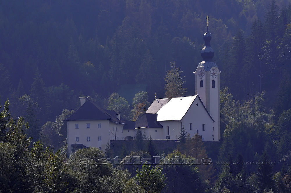 Church in shadow of mountain