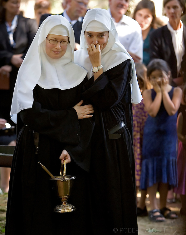 BETHLEHEM, CT- 10 OCTOBER 2005-Sister Chava Palmer and Sister Alma Egger of the Abbey of Regina Laudis watch as the casket of Lady Abbess Benedict Duss, O.S.B. is lowered into the grave during Lady Abbesses Monastic Burial on the grounds of the Abbey of Regina Laudis. The Lady Abbess was the foundress and first Abbess of the Abbey of Regina Laudis which began 57 years ago.   <br /> (Photo by Robert Falcetti)