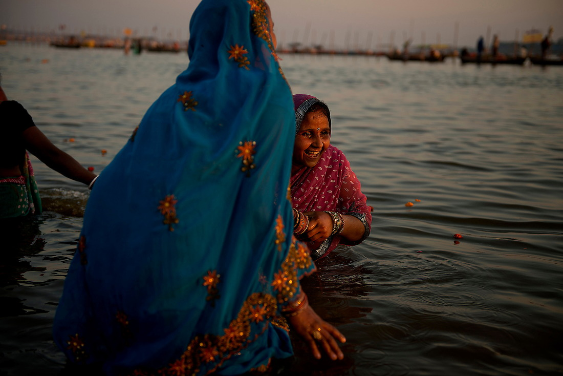 A couple of Hindu pilgrims enter the river for a bathe on February 8, 2013 in Allahabad, India during the Kumbh Mela. — © Jeremy Lock/