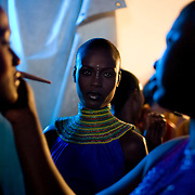 """Nigerian models prepare backstage for a show by African fashion designer Deola Sagoe during the July 13, 2008 leg of the ThisDay music and fashion festival in Lagos, Nigeria. The festival, themed """"Africa Rising"""", aims to raise awareness of African issues while promoting positive images of Africa using music, fashion and culture in a series of concerts and events in Nigeria, the United States and the United Kingdom. ."""