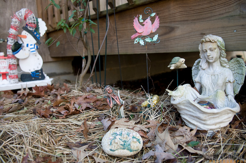 """Date: 1/08/09.Desk: STL.Slug: WOMYN.Assign ID: 30074969A..Lawn ornaments at the home of Emily Greene, 62, at Alapine, a """"womyn's land"""" or lesbian intentional community, in rural northeast Alabama. ..(*the exact town/location of the community cannot be revealed in the caption or article, per agreement with the subjects)..Photo by Angela Jimenez for The New York Times .photographer contact 917-586-0916"""