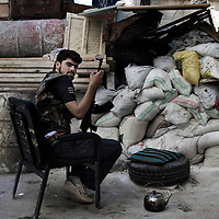 SYRIA, ALEPPO. Free Syrian Army fighter at the front line in Salaheddin neighborhood on September 26, 2012. ALESSIO ROMENZI