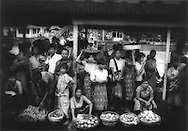 Arriving in Twante, Burma: Vendors line the landing in Twante, Burma.