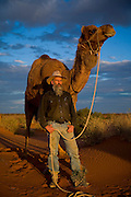 Camel Trek just outside William Creek in North Eastern South Australia. Philip Gee with Sir Wobble on the sand dunes outside william creek. Considered to be one of Australia's leading camel men Philip Gee has been a senior guide with Explore the Outback camel safaris since 1987 and he has trained hundreds of wild camels. Philip who is a specialist Historian has led countless expeditions into this wilderness over the past 20 years and knows the Lake Eyre desert country very well. Explore the Outback camel safaris are based in the central Australian deserts near William Creek along the Oodnadatta Track (Lake Eyre, South Australia), and operate from April through to October every year..