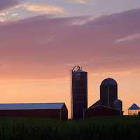 Town of Wallkill, New York - A barn and silos are seem against the dawn sky on July 29, 2014. ©Tom Bushey / The Image Works