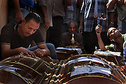 Egyptian Coptic Christian men mourn over caskets for victims of sectarian violence October 10, 20011 at the Coptic Hospital in Cairo, Egypt. At least 26 people, mostly Christian, were killed during sectarian clashes that saw the worst violence since the Revolution that toppled former Egyptian president Hosni Mubarak earlier this year. Egyptian Coptic Christians make up about 10% of Egypt's 80 million population and periodically violence flares between the Christian minority and the majority Muslim population. (Photo by Scott Nelson)
