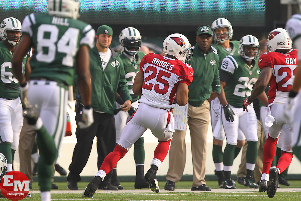Dec 2, 2012; East Rutherford, NJ, USA; Arizona Cardinals free safety Kerry Rhodes (25) returns an interception of a New York Jets quarterback Mark Sanchez (6) pass during the first half at MetLIfe Stadium.