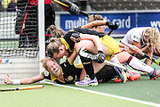 AMSTERDAM - Amsterdam - Den Bosch , Wagener Stadion , Hockey , Play-off hoofdklasse hockey , 03-05-2015 , Margo van Geffen viert haar doelpunt voor de 0-2 met Vera Vorstenbosch (r)