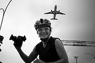 Sao Paulo, Brazil, Saturday - February 11, 2012: Renata Falzoni, journalist and cycle activist, during her trip to map the Olympic sites in Rio de Janeiro, the city of 2016 Olympic Games. Renata rode her bike from her house, in Sao Paulo, to Sao Paulo's airport, took the first flight to Rio, and cycled again. From downtown to outskirts, from south to north, looking for each site that will shelter a competition. Renata reaches Sao Paulo's airport.  (photo: Caio Guatelli)