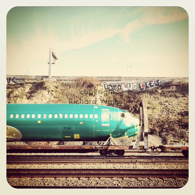 2013 November 25 - A new Boeing 737 plane is transported by rail through Georgetown, Seattle, WA, USA. Taken/edited with Instagram App for iPhone. By Richard Walker