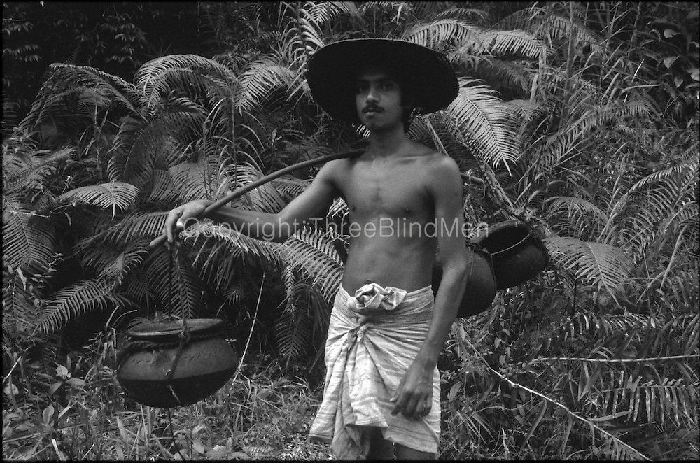 Toddy Tapper in the Sinharaja forest.<br /> circa 1985