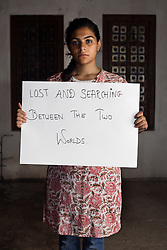 Parveen Khan - 17 yrs.Father Muslim / Mother (French) Christian / Lives in Hindu area.Amber, Jaipur, Rajastan.Schoolgirl.'Lost and searching between the two worlds'.