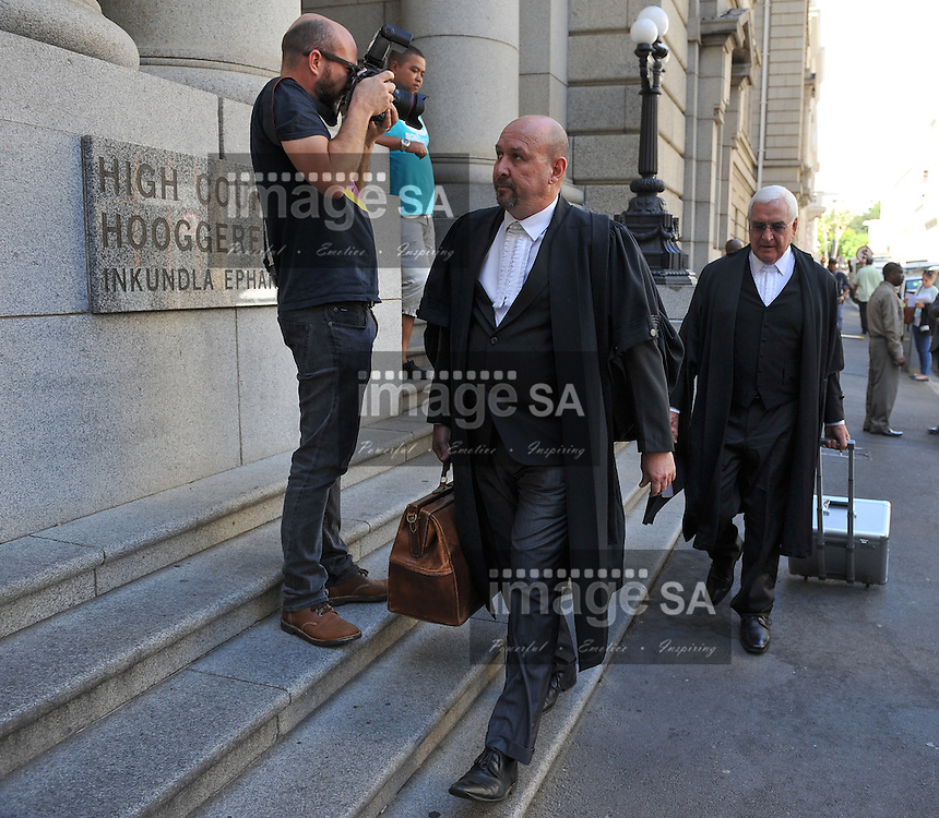 CAPE TOWN, SOUTH AFRICA - Monday 13 October 2014, Advocate Francois van Zyl SC (back), defence counsel, arrives at court during Day 5 of the Shrien Dewani trial at the Western Cape High Court before Judge Jeanette Traverso. Dewani is caused of hiring hit men to murder his wife, Anni. Anni Ninna Dewani (n&eacute;e Hindocha; 12 March 1982 &ndash; 13 November 2010) was a Swedish woman who, while on her honeymoon in South Africa, was kidnapped and then murdered in Gugulethu township near Cape Town on 13 November 2010 (wikipedia).<br /> Photo by Roger Sedres
