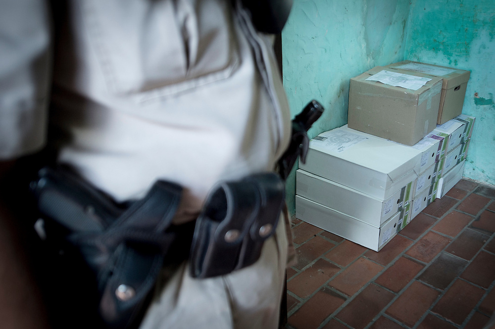 USE ARROWS on your keyboard to navigate this slide show<br /> <br /> Chacoi, Paraguay - 20 April 2013<br /> A policeman monitors the ballots boxes before the election staff transport them to the polling stations.<br /> Photo: EUEOM Paraguay / Ezequiel Scagnetti