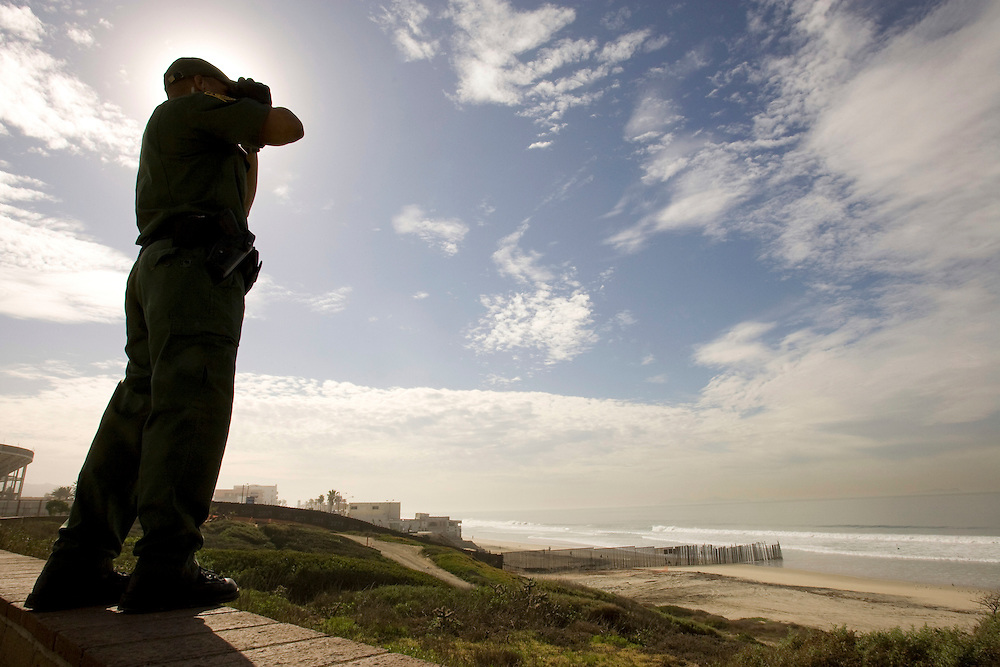 A U.S. Border Patrol agents scans the border with Mexico where the fence enters the Pacific Ocean at Imperial Beach, California on January 20, 2008. Please contact Todd Bigelow directly with your licensing requests.