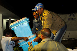 Ballot boxes and other materials for voting are loaded onto trucks and transported from Gleno to outer areas where they are made ready for voting on June 30 2007 Timor-Leste Parliamentary Elections.