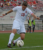Ohio State defender Jordan Lomnicki (13) crosses the ball as OSU takes on Binghamton in the first half of an NCAA men's college soccer game in Columbus, Ohio on Sunday, Sept. 11, 2011, at Jesse Owens Memorial Stadium.