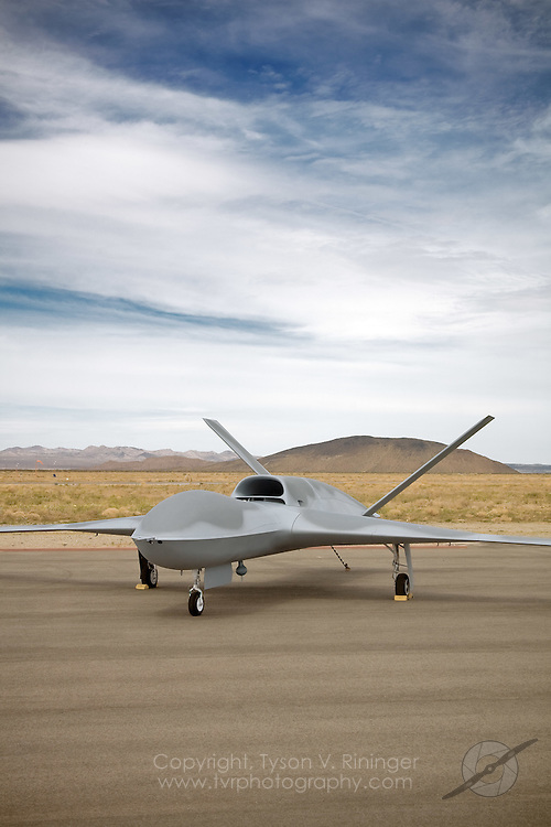 """General Atomics P46 Predator 'C', """"Avenger"""" sits on the ramp at Grey Butte Airfield. The latest generation Predator is a jet-powered remotely-piloted vehicle (RPV) that is nearly twice the size of its predecessor. Featuring an internal weapons bay, retractable gear, a blended wing design, top-mounted intake and shielded exhaust, the stealthy airframe can cruise at 50,000 feet and can perform multiple tasks from reconnaisance to attack roles."""
