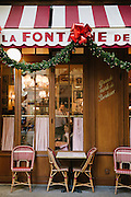 View of customers and waiters from a window outside La Fontaine de Mars restaurant in Paris