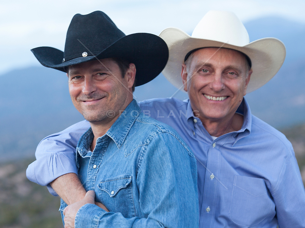mature cowboy and a middle aged cowboy enjoying time together in Santa Fe, New Mexico