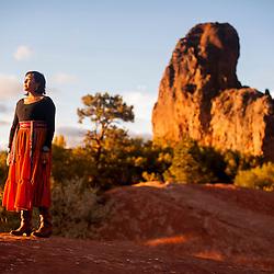 Kayla Begay stands in front of Frog Rock in Navajo, N.M.