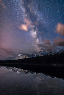 The summer Milky Way in portrait orientation over Herbert Lake and Mount Temple and peaks around Lake Louise, in Banff National Park, Alberta. Taken August 29, 2016. <br /> <br /> This is a stack of 10 images for the ground, mean averaged to smooth noise, and one image for the ground and lake reflections to minimize star trailing. All are 25 seconds at f/2 with the Sigma 20mm Art lens and Nikon D750 at ISO 5000.