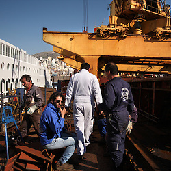 Captain Aleksandar Kovacevic, center, walks the deck of the Alfa K, a Mediterranean based bulk carrier with a Panamanian flag, as it undergoes repairs at the port of Piraeus in Greece on Feb. 20, 2008. Inspectors impose ITF-standard treaties on ship-owners to guarantee minimal standard working conditions for seafarers. They are on call 24 hours a day to address concerns from workers coming to port on the international ships.