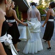 As the ceremony nears a bride is guided by her bridesmaids about the church.