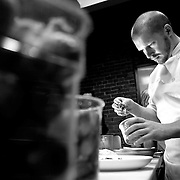 "SHOT 2/20/12 4:36:25 PM - Chef Sam Freund of Denver, Co. works on a dish in the kitchen at TAG restaurant on Larimer Square in downtown Denver, Co. TAG is owned and operated by chef/owner Troy Guard. TAG features what they term ""continental social food"" and features influences from numerous continents. .(Photo by Marc Piscotty / © 2012)"