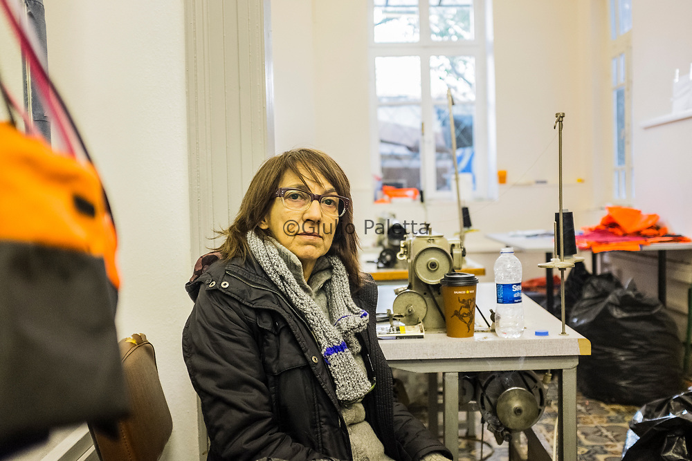"""Matina Kontoleontos, Greek designer who created in Mytilene, Lesbos capital, the project """"Safe Passage"""", a design laboratory which creates and sells bags and accessories from the refugees' life jackets. She managed to employ for this project 10 refugees who arrived in Lesbos by boat during the past year"""