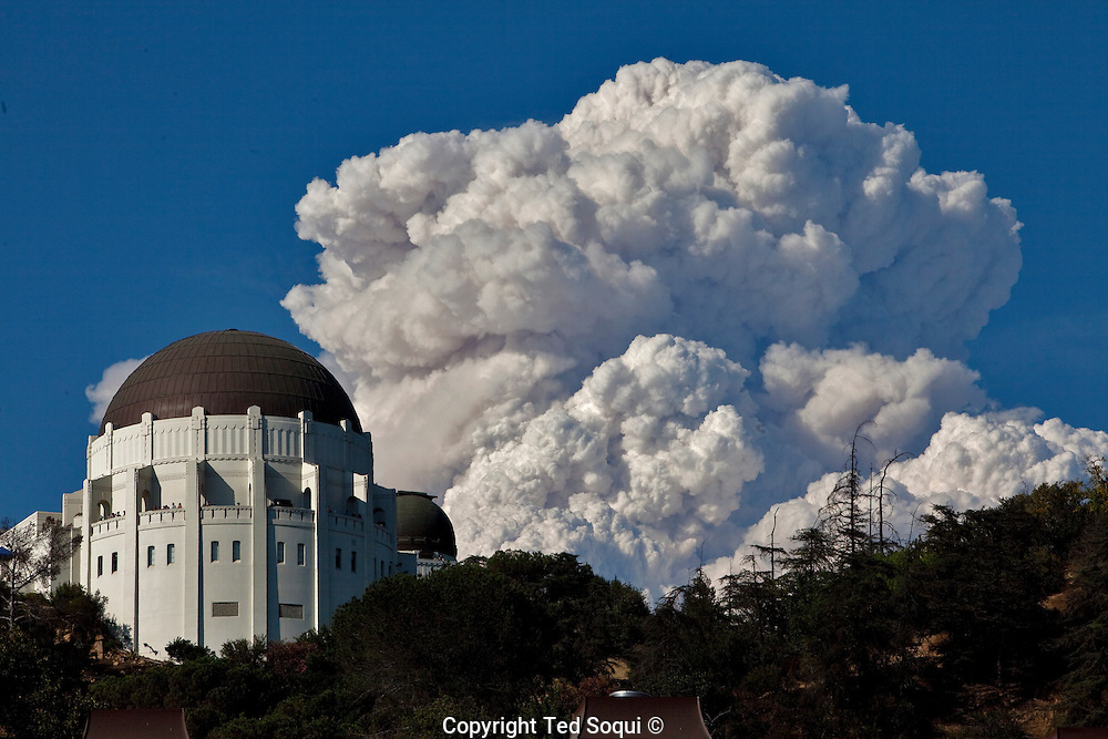 Giant smoke plume rises up to 20,000 feet from the Station fire. The Griffith Observatory is on the foreground..