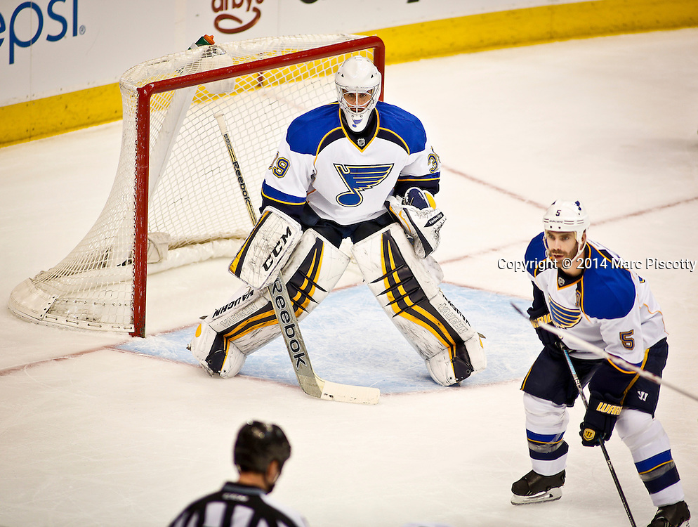 SHOT 3/8/14 2:25:36 PM - St. Louis Blues goaltender Ryan Miller #39 prepares for a face-off in his own zone against the Colorado Avalanche during their regular season Western Conference game at the Pepsi Center in Denver, Co. The Blues won the game 2-1.<br /> (Photo by Marc Piscotty / &copy; 2014)
