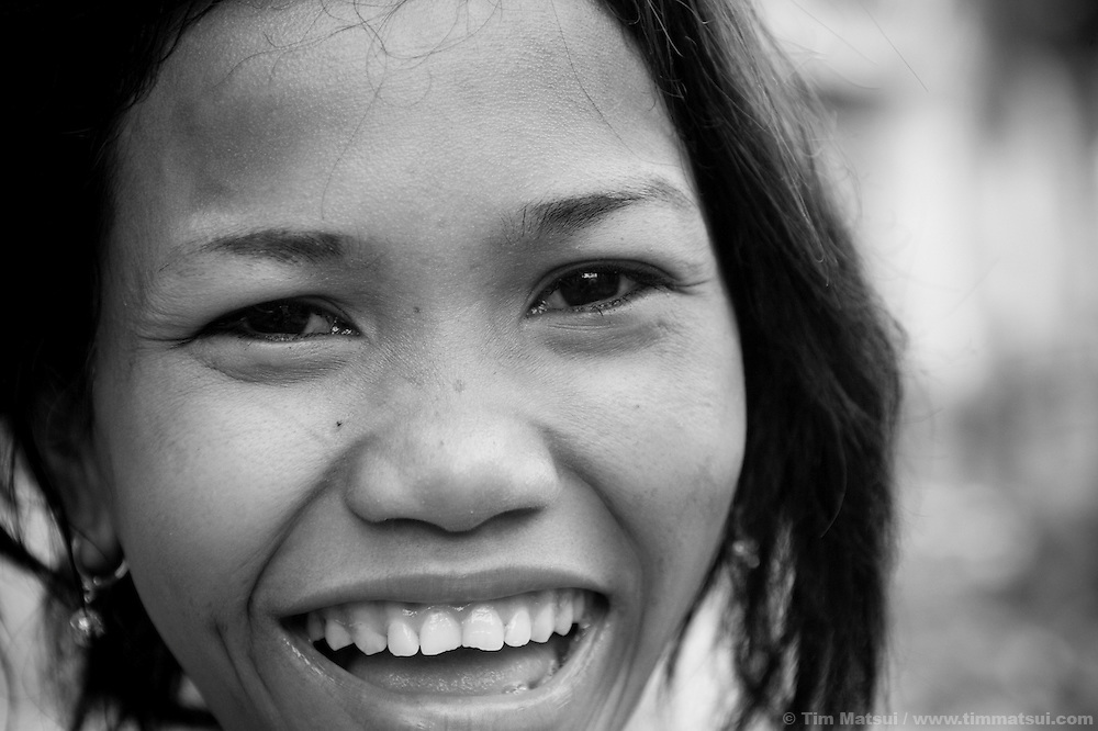 """Jene, who says she is 19, at home in a slum where the non governmental organization """"Acting for Women in Distressing Situations"""" (AFESIP), conducts outreach and provides services in Phnom Penh, Cambodia. The permanent structure, a decaying four story building known simply as 'The Building', was built in the 1960's as transitional housing and now hosts a shantytown where many of the city's poor live, including many prostitutes, and is believed to have the highest rate of HIV infection in the city. AFESIP hands out free condoms, instructs prostitutes on HIV prevention, and conducts outreach in case the prostitutes need medical services, choose to leave their profession, or can report on cases of sex trafficking. AFESIP offers housing, education, training, and counseling for women who are victims of sex trafficking, worked as prostitutes, or are escaping domestic violence. Founded by Somaly Mam, who herself was once a prostitute and victim of trafficking and domestic abuse, AFESIP has three facilities in Cambodia and works with other NGO's to provide long term care for the women."""
