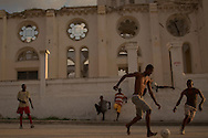Port-au-Prince, HAITI, 22/03/2011: One year after the massive earthquake hit Haiti's capital, people try to recover their quotidian life, in the middle of a destructed city. A soccer game beside the cathedral ruins.  (photo: Caio Guatelli)
