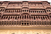 A Haveli is a private mansion in India; these vernacular buildings are noted for their carvings and frescos with images of animals and various gods. Havelis were traditional status symbols for the Marwari, the Indian ethnic group in Rajasthan.  They also provided homes, with security in seclusion from the outside world.