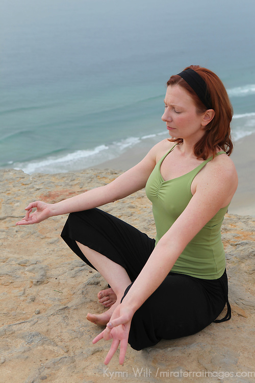 USA, California. Healthy woman, 30's - 40's, meditating outdoors.