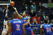 "SMU's London Giles (11) has his shot blocked by Ole Miss' Reginald Buckner (23) at the C.M. ""Tad"" Smith Coliseum in Oxford, Miss. on Tuesday, January 3, 2012. Ole Miss won 50-48."