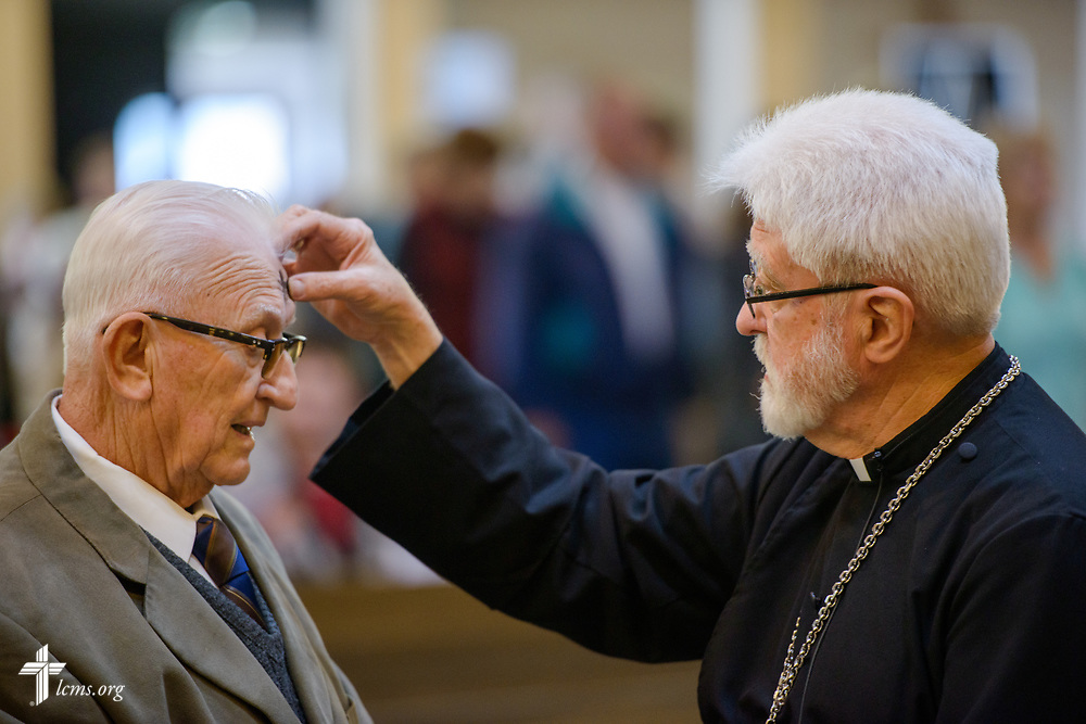 The Rev. Thomas Handrick, Sr., pastor of Immanuel Lutheran Church, Perryville, Mo., places ashes on church member Alfred Dreyer on Wednesday, March 1, 2017, at the church in Perryville, Mo. A violent tornado ripped through parts of the area the night before. LCMS Communications/Erik M. Lunsford