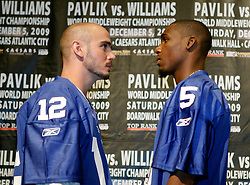 Sept 29, 2009; East Rutherford, NJ, USA; World Middleweight Champion Kelly Pavlik (l) and Paul Williams (r) pose during the press conference announcing their December 5, 2009 World Middleweight Championship fight. The two will meet at Boardwalk Hall in Atlantic City, NJ.  Mandatory Credit: Ed Mulholland