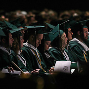 Wilmington University Students review programs during  commencement exercise Sunday, May 17, 2015, at Chase Center On The Riverfront in Wilmington Delaware.