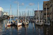 Conch fisher sailboat Belize City<br /> Swing Bridge<br /> Belize City<br /> Central America