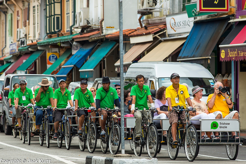 17 DECEMBER 2012 - SINGAPORE, SINGAPORE:  Tourists ride down Arab Street in the Arab section of Singapore in pedicabs.      PHOTO BY JACK KURTZ